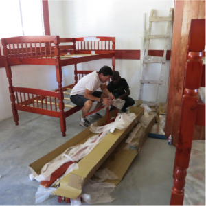 Jonathon and a volunteer put together a bunk bed for the new dorms