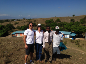 Jonathon with FTC Haiti director Erin Barton, a school director and a farmer who donated land to make the school a reality.