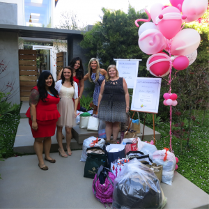 The ladies of Project Hope standing with some of the bags collected from the event. The clothes collected were given to the women rescued by the Project Hope team.