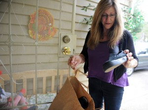 Woodbridge resident Mary Avanti looks over donated shoes someone left on her doorstep