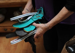 Woodbridge resident Mary Avanti holds newly donated shoes at her home in Woodbridge Thursday.